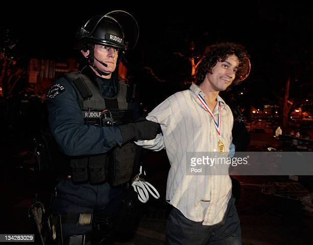 A protester is arrested as Los Angeles police officers dismantle the Occupy LA encampment following a raid by LAPD on November 30 2011 in Los Angeles...