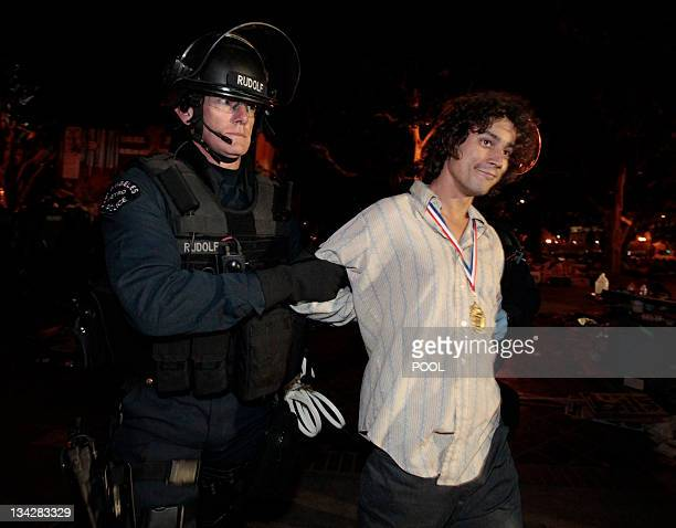 A protester is arrested as Los Angeles police officers dismantle the Occupy LA encampment outside City Hall in Los Angeles November 30 2011 The...