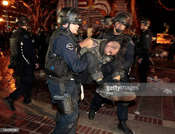 A protester is arrested as Los Angeles police officers dismantle the Occupy LA encampment following a raid by LAPD in the early house of November 30...