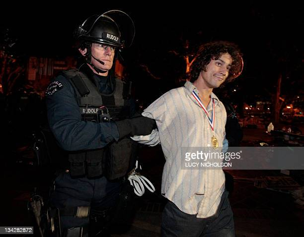 A protester is arrested at the Occupy Los Angeles encampment outside City Hall on November 30 2011 Hundreds of riot police flooded into downtown Los...