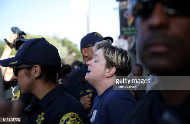 A protester is arrested by Alameda County sheriff during a demonstration outside of Zellerbach Hall on the UC Berkeley campus on September 14 2017 in...