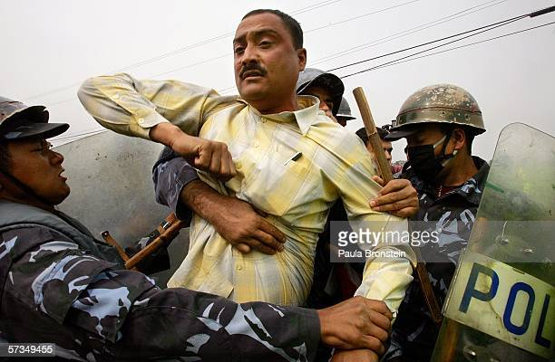 Protester is arrested by Nepalese armed police for trying to march in the banned protesting area against the rule of King Gyanendra April 17, 2006 in...