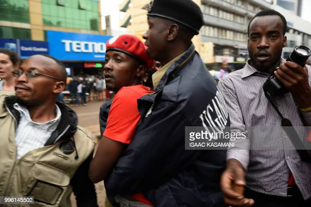A protester is arrested by police during a demonstration on July 11 2018 in Kampala to protest a controversial tax on the use of social media Police...
