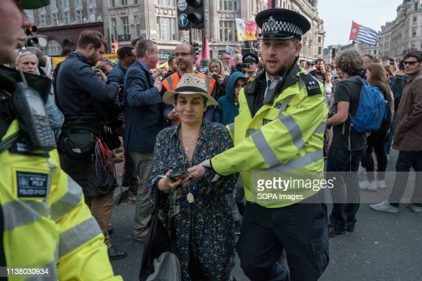 A protester is arrested by police officers during the Extinction Rebellion Strike in London Extinction Rebellion have blocked five central London...