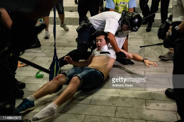A protester is arrested during a clash after a rally against the extradition law proposal at the Central Government Complex on June 10 2019 in Hong...