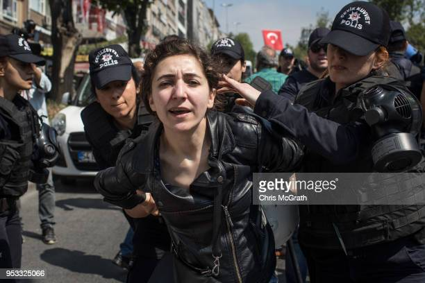 A protester is arrested during a clash with police on a street in the Besiktas neighbourhood during a May Day demonstration on May 1 2018 in Istanbul...