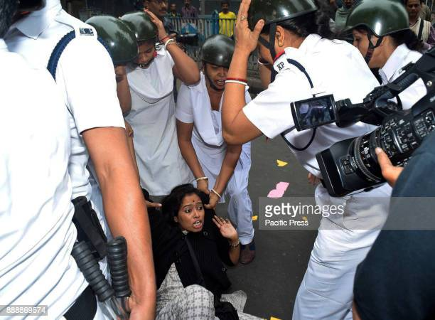 A protester is arrested during a march organised by students of Calcutta University and Presidency College to protest the killing of Afrajul a Muslim...
