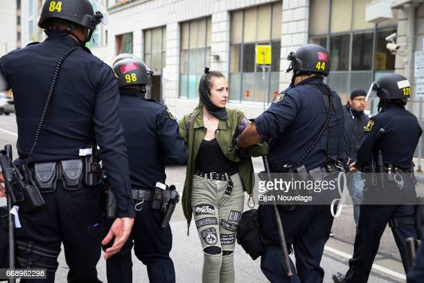 A protester is arrested following a 'Patriots Day' free speech rally on April 15 2017 in Berkeley California More than a dozen people were arrested...