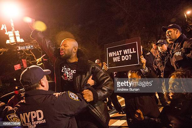 A protester is arrested for blocking traffic while calling for further action against Daniel Pantaleo the New York Police Officer who used a New York...