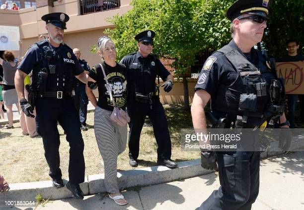 Protester is arrested while protesting the visitof Attorney General Jeff Sessions Friday July 13 2018