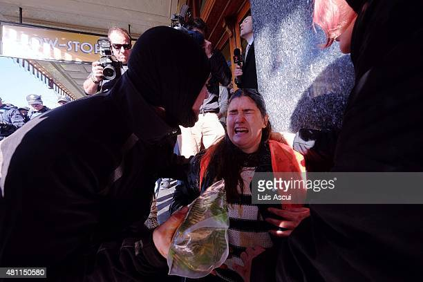 A protester is cared for after police use pepper spray on antiReclaim Australia protesters on July 18 2015 in Melbourne Australia 'Reclaim Australia'...
