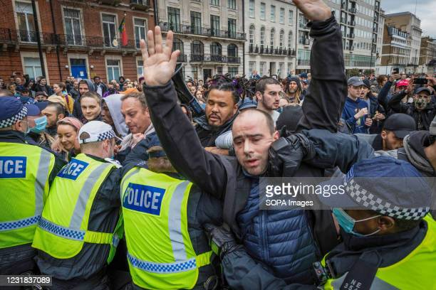 Protester is caught up in scuffles between the MET police and protesters who were taking part during the demonstration. Thousands of protesters take...