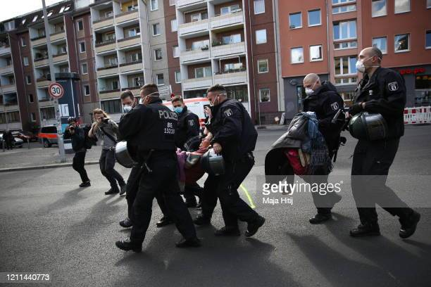 A protester is detained by police during a demonstration at Rosa Luxemburg Platz on May Day during the novel coronavirus crisis on May 1 2020 in...