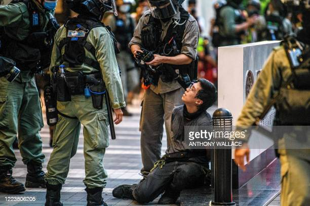 Protester is detained by police during a rally against a new national security law in Hong Kong on July 1 on the 23rd anniversary of the city's...