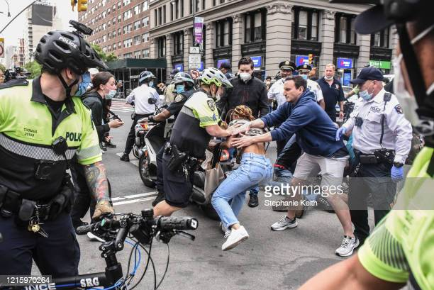 A protester is detained by police during a rally against the death of Minneapolis Minnesota man George Floyd at the hands of police on May 28 2020 in...