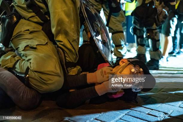 A protester is detained by riot police during an antigovernment rally in Wong Tai Sin district on August 24 2019 in Hong Kong China Prodemocracy...