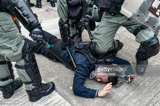 A protester is detained by riot police during an antigovernment rally in Kowloon Bay district on August 24 2019 in Hong Kong China Prodemocracy...