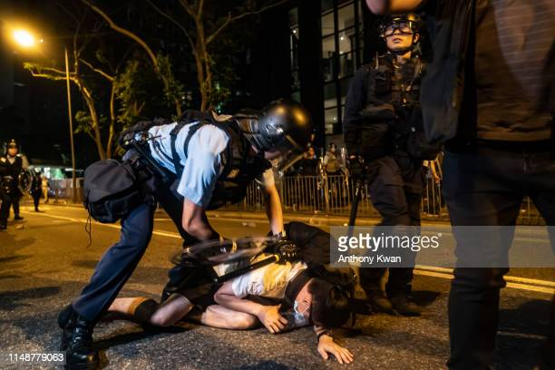 A protester is detained during a clash after a rally against the extradition law proposal at the Central Government Complex on June 10 2019 in Hong...