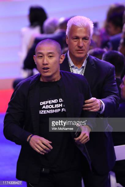 A protester is escorted out of the auditorium by security during the Democratic Presidential Debate at Texas Southern University's Health and PE...