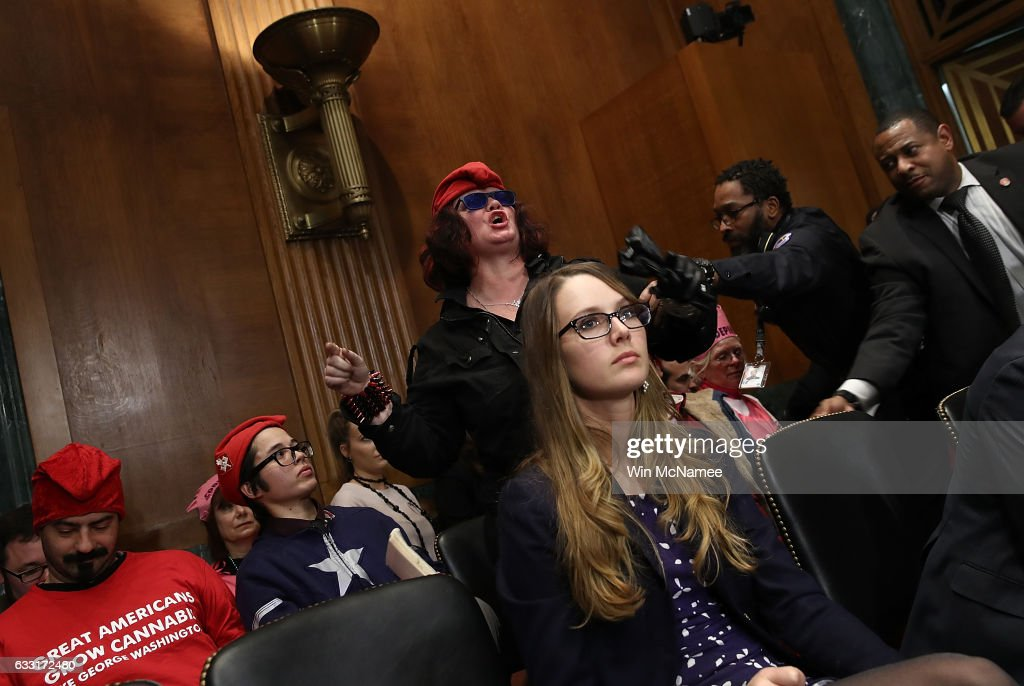 A protester is led away by U.S. Capitol Police after disrupting the Senate Judiciary Committee's 'markup' on the nomination of Sen. Jeff Sessions to be the next Attorney General of the U.S. January 31, 2017 in Washington, DC. The nomination of Sessions to be the next Attorney General has been complicated by the recent firing of Acting Attorney General Sally Yates by U.S. President Donald Trump.