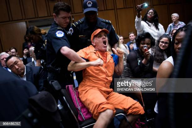 Protester is removed before a confirmation hearing of CIA nominee Gina Haspel before the Senate Select Intelligence Committee on Capitol Hill May 9,...