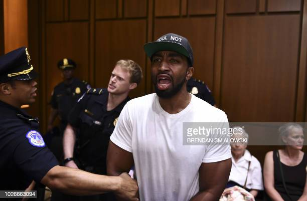 A protester is removed during a hearing of the Senate Judiciary Committee on the nomination of Brett Kavanaugh to the US Supreme Court September 4...