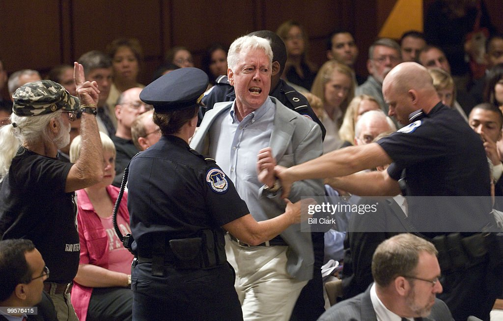 A protester is removed form the hearing room after shouting anti-war statements as Armed Forces Commander in Iraq Gen. David Petraeus and U.S. Ambassador to Iraq Ryan Crocker make their opening statements during the Senate Foreign Relations Committee hearing on 'Iraq: The Crocker-Petraeus Report'on Tuesday, Sept. 11, 2007.