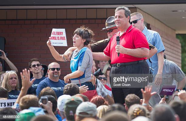 Protester is removed from the stage by police after she interupted a speech by Republican presidential candidate New Jersey Governor Chris Christie...