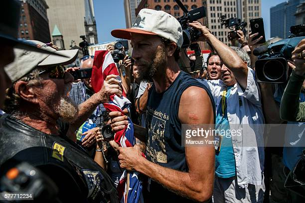 CLEVELAND OHIO TUESDAY JULY 19 2016 A protester is scolded for allowing the American flag to touch the ground by a member of Bikers for Trump on the...