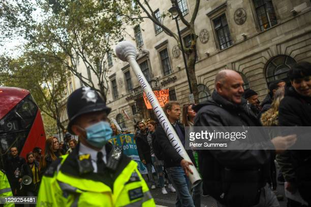 A protester is seen carrying a giant swab during a Unite for Freedom march on October 24 2020 in London England Hundreds of antimask and antilockdown...