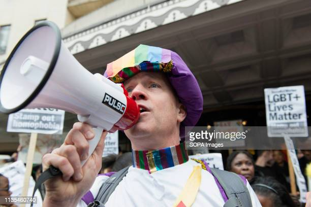 A protester is seen chanting slogans on a megaphone during the Protest condemning the new antiLGBTIQ laws brought in by the Sultan of Brunei...