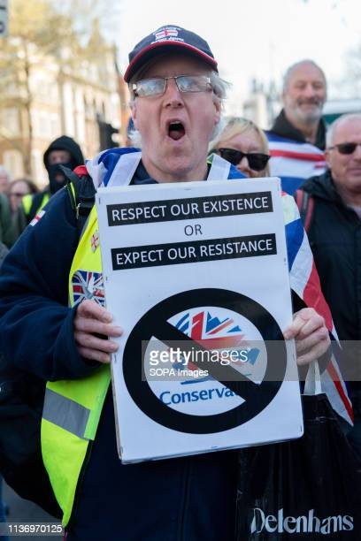 A protester is seen holding a placard during the demonstration Protesters gathered at Parliament Square and marched to different places including...