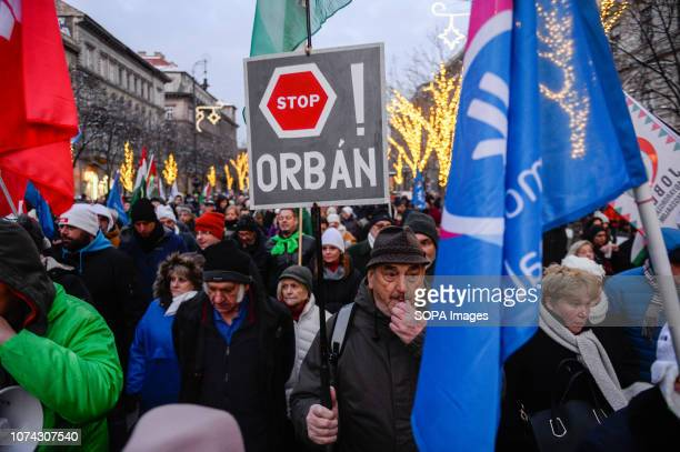A protester is seen holding a placard during the protest against the new labour law approved by the right wing conservative government lead by Viktor...