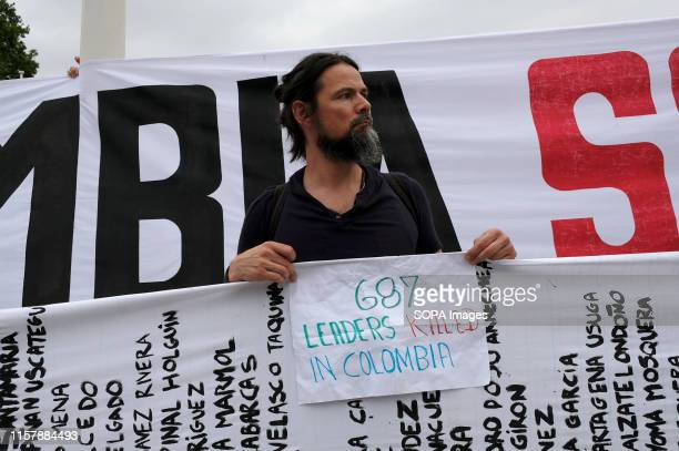 A protester is seen holding a placard that reads 687 leaders killed in Colombia Colombians gathered outside the BBC in London to protest against the...