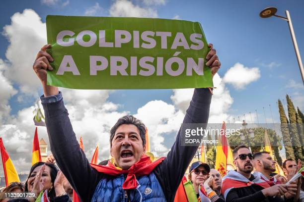 A protester is seen holding a placard that says coup plotters to prison during the demonstration The political formation of Santiago Abascal has...