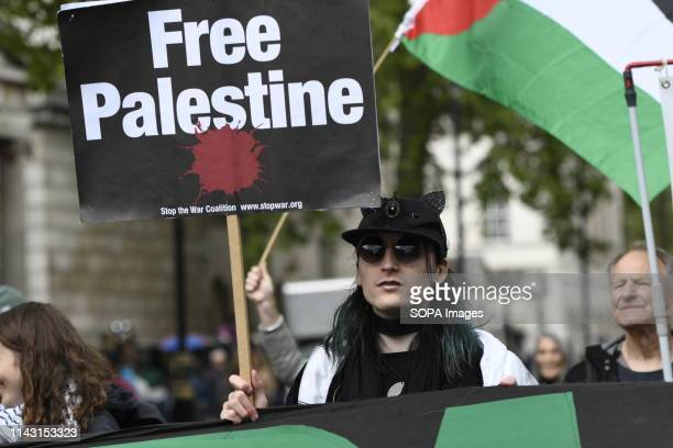 A protester is seen holding a placard that says free Palestine during the demonstration Palestinian human rights activist Ahed Tamimi joined the...