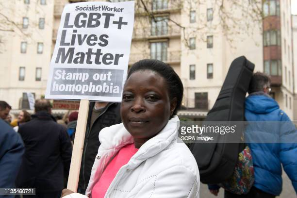 A protester is seen holding a placard that says LGBTQ lives matter stamp out homophobia during the protest condemning the new antiLGBTIQ laws brought...