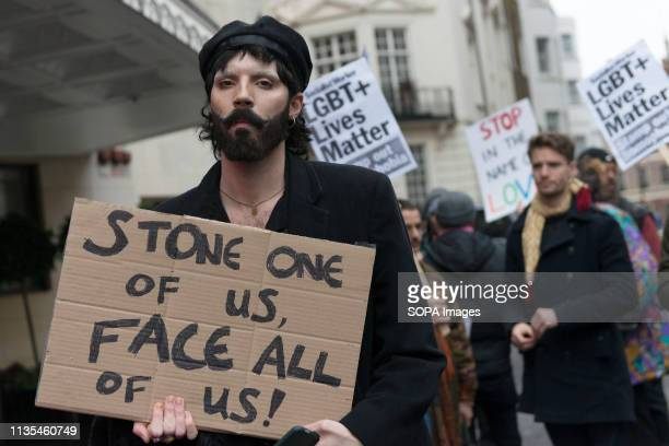 A protester is seen holding a placard that says Stone one of us face all of usduring the Protest condemning the new antiLGBTIQ laws brought in by the...