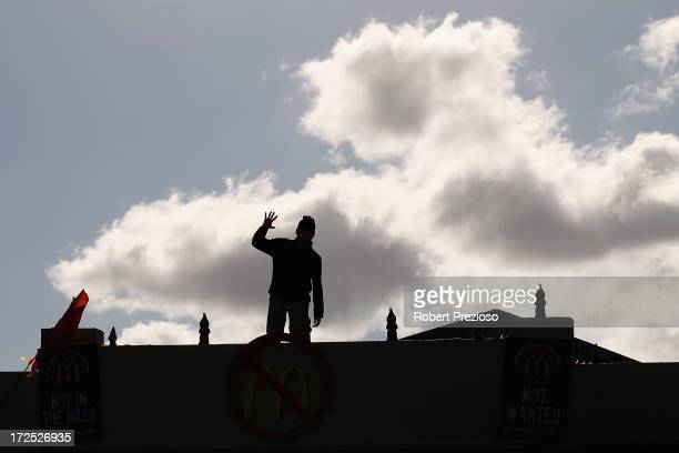 A protester is seen on July 3 2013 in Melbourne Australia Janine Watson is spending her third consecutive day on the rooftop of a building currently...