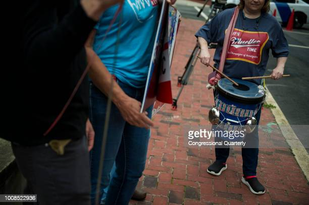 A protester is seen outside of the United States District Court in Alexandria Virginia where President Donald Trump's former campaign manager Paul...