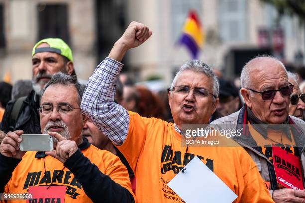 A protester is seen raising his fist during the demonstration Hundreds of retirees and pensioners have demonstrated in the streets of Barcelona in...