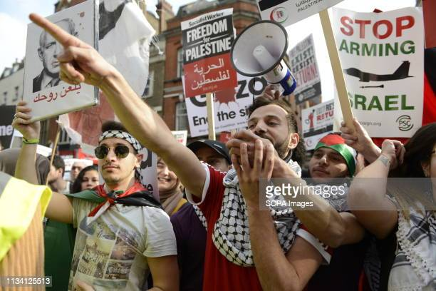 A protester is seen shouting slogans a megaphone during the Exist Resist Return Rally for Palestine in London People gather outside the Israeli...