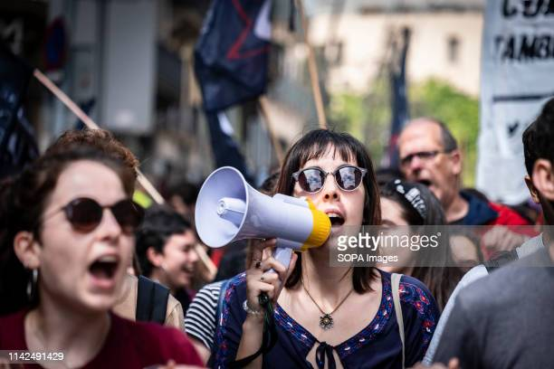 A protester is seen shouting slogans on a megaphone during the demonstration Under the slogan Let's recover the university hundreds of secondary and...