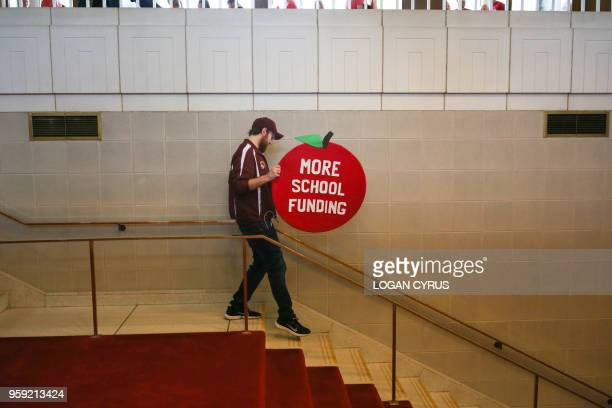 A protester is seen walking down the stairs of the State Capitol building as teachers from across the state of North Carolina march and protest in...