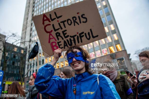 A protester is seen wearing a blue costume and holding a placard saying All clitoris are beautiful during the demonstration Several organizations...