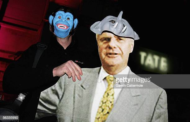 A protester is seen with a cardboard cutout of Paul Myners the chairman of the Tate Gallery at the Turner Prize 2005 at Tate Britain on December 5...