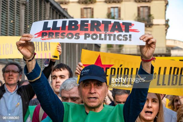 A protester is seen with a sign calling for the freedom of political prisoners Hundreds of people have concentrated protesting the maintenance of...
