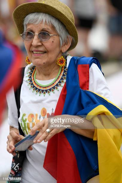 A protester is seen with the Colombian flag in her arm during the protest in London Colombians gathered outside the BBC in London to protest against...