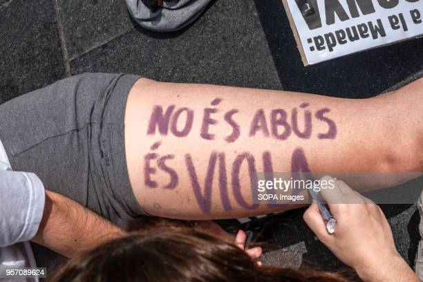 A protester is seen writing it is not abuse it is rape on the body of another person Under the slogan it's not abuse it's rape more than 5000 high...