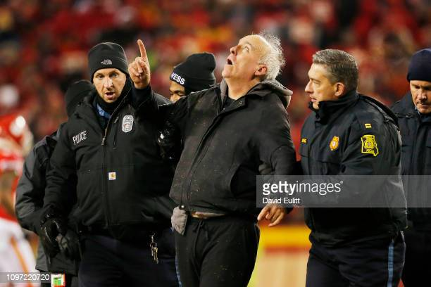 A protester is taken off the field by security during the AFC Championship Game between the Kansas City Chiefs and the New England Patriots at...